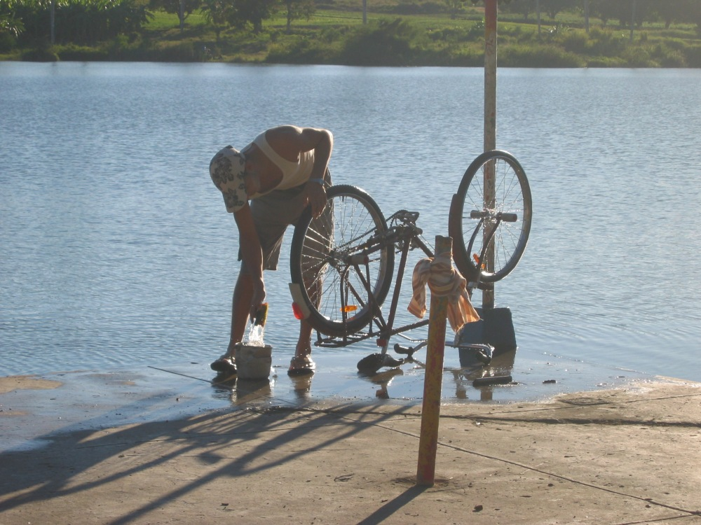 Cuban man washing his bike